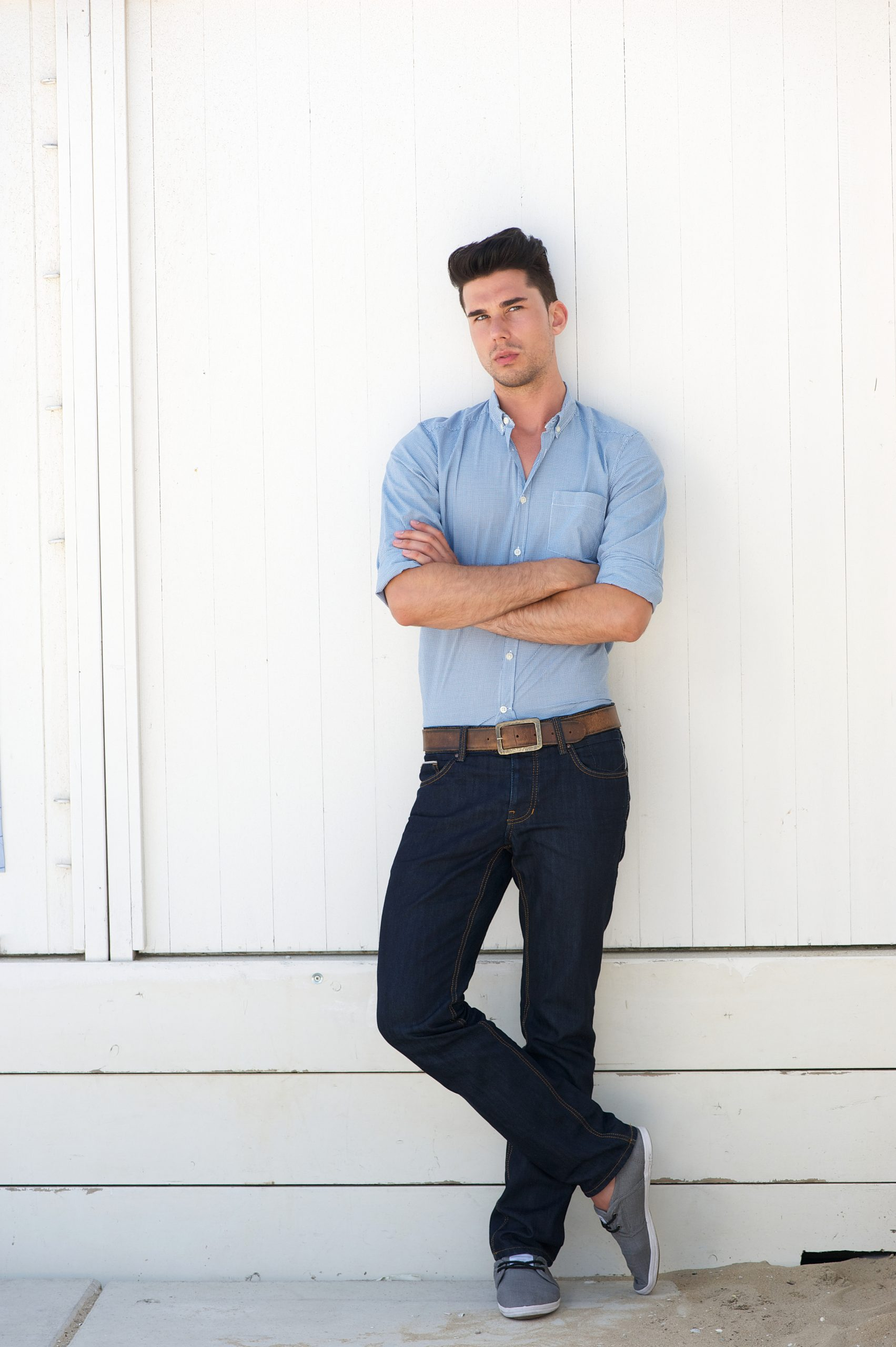young-male-fashion-model-in-blue-jeans-and-shirt-PPKYYDU-scaled.jpg